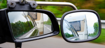 car-towing-caravan-in-mirror-min.jpg
